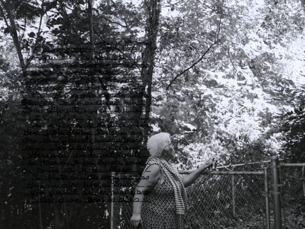 Photo of a woman leaning on a fence with black text overlaid on the photo.