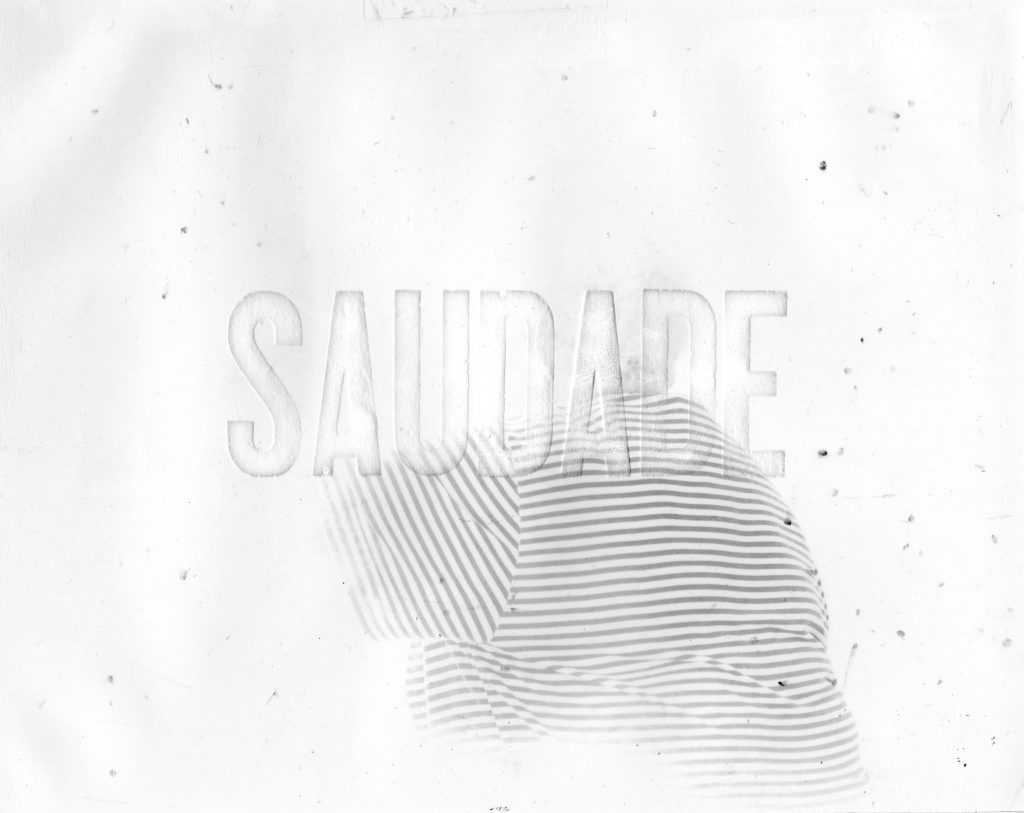 "Image of a fingerprint with the word ""Saudade"""